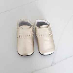 New in box Jack & Lily gold Moccasins 30-36 Months